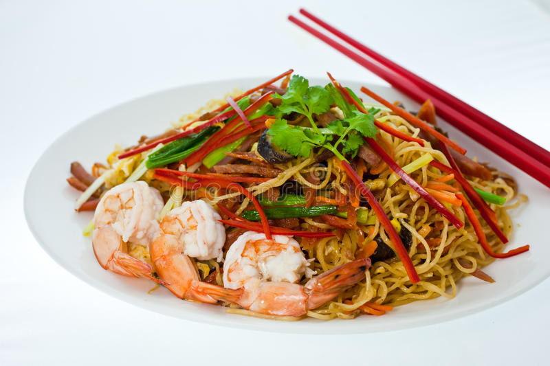 Chinese Noodle1. Chow mein, Chinese Noodle, is an American Chinese stir-fried dish consisting of noodles, shrimp, and cabbage and other vegetables royalty free stock photo
