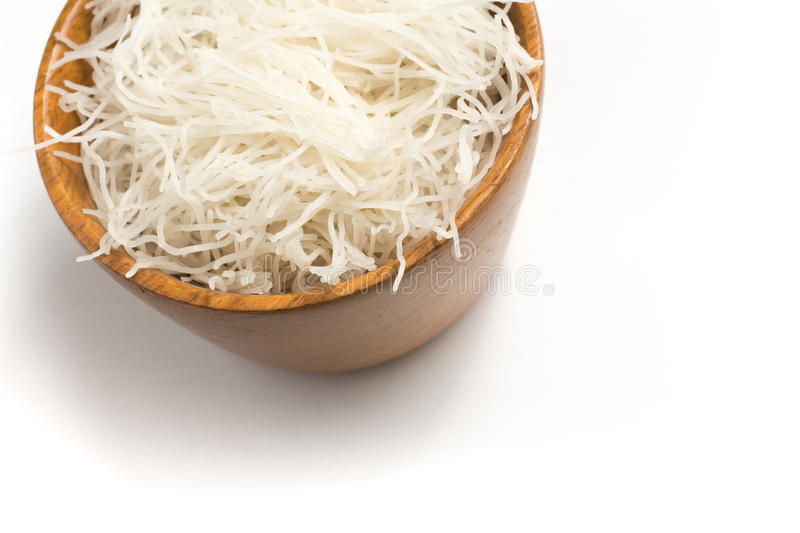 Chinese Noodles. Rice vermicelli Pasta into a bowl. Isolated in white background stock image