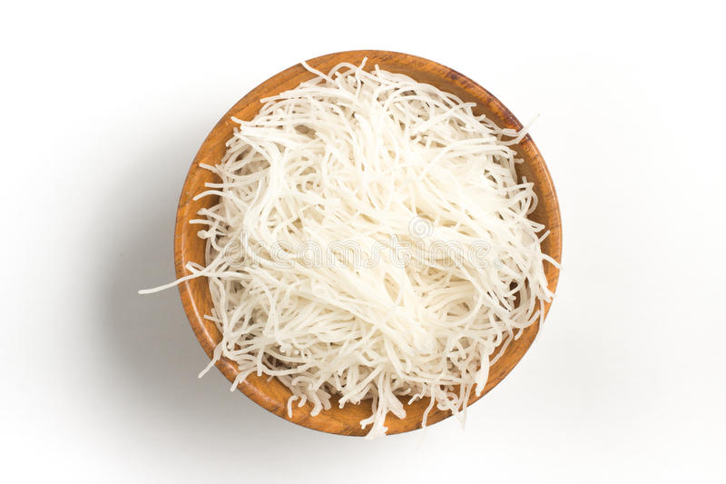 Chinese Noodles. Rice vermicelli Pasta into a bowl. Isolated in white background stock photography