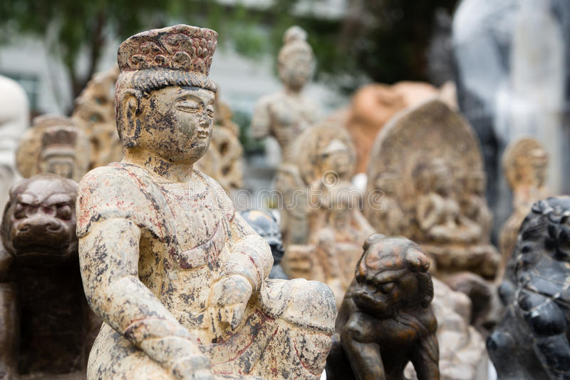 Chinese old sculptures in stone at a flea market. In Beijing royalty free stock image