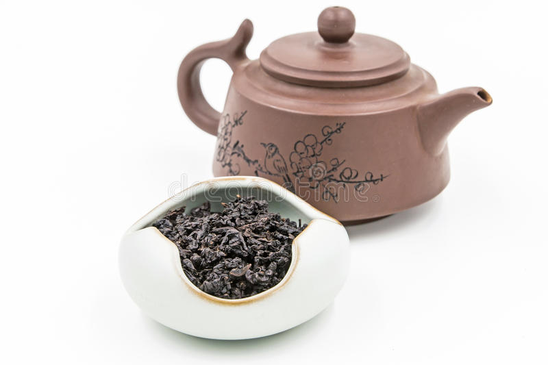 Chinese Oolong Dark Red tea Black Tie Guan Yin with small pot stock image