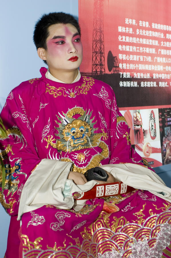 Chinese opera - actor. CHINA, GUANGDONG, SHENZHEN - MAY 18, 2009: China Cultural Industries Fair: opera actor from Shanxi province, having rest after performance royalty free stock image