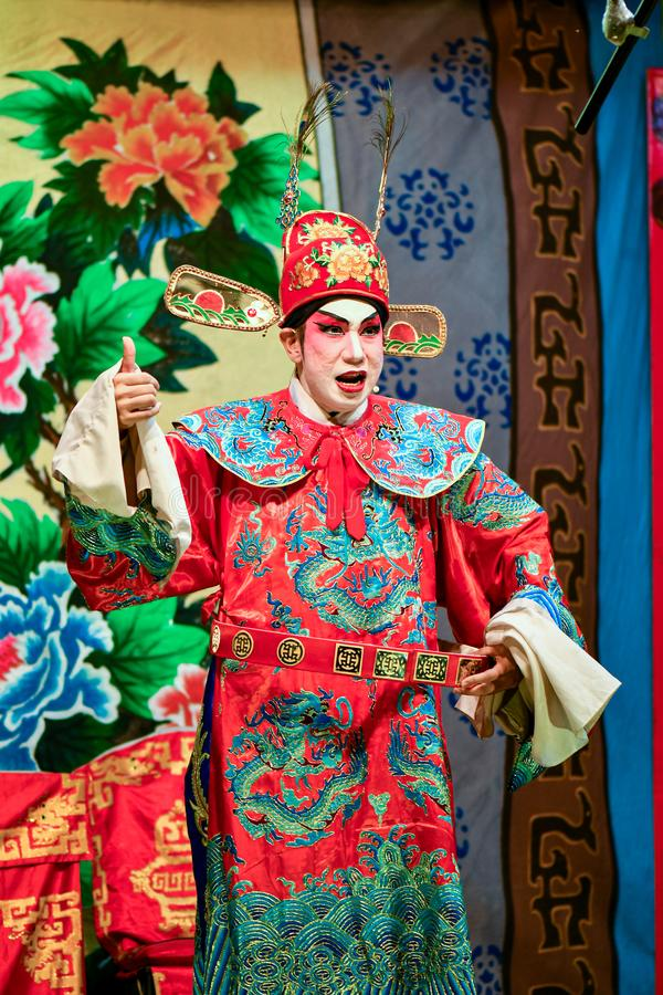 Chinese Opera actor and actress with full makeup. On stage, Teochew style costume and makeup royalty free stock images