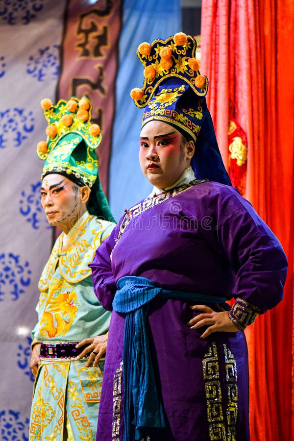 Chinese Opera actor and actress with full makeup. On stage, Teochew style costume and makeup stock image