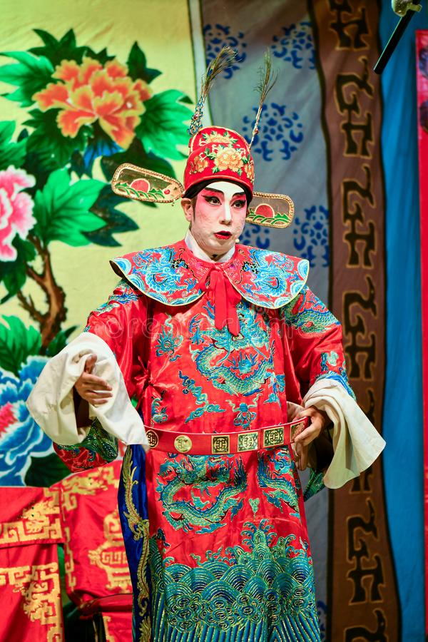Chinese Opera actor and actress with full makeup. On stage, Teochew style costume and makeup royalty free stock photography