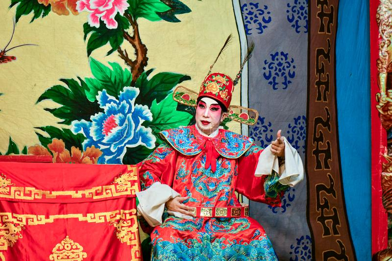 Chinese Opera actor and actress with full makeup. On stage, Teochew style costume and makeup stock photo