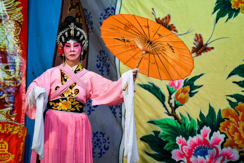 Chinese Opera actor and actress with full makeup. On stage, Teochew style costume and makeup stock images