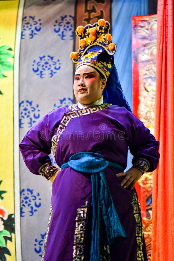 Chinese Opera actor and actress with full makeup. On stage, Teochew style costume and makeup stock photos