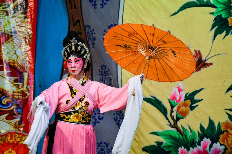 Chinese Opera actor and actress with full makeup. On stage, Teochew style costume and makeup royalty free stock photo