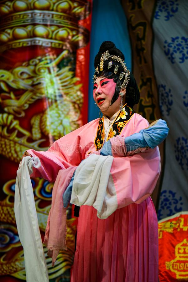 Chinese Opera actor and actress with full makeup. On stage, Teochew style costume and makeup stock photography