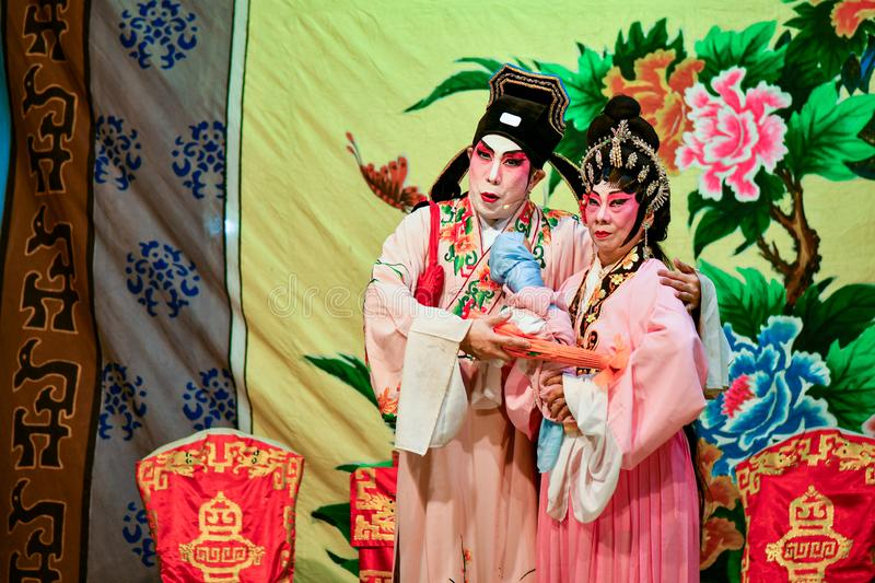 Chinese Opera actor and actress with full makeup. On stage, Teochew style costume and makeup royalty free stock image