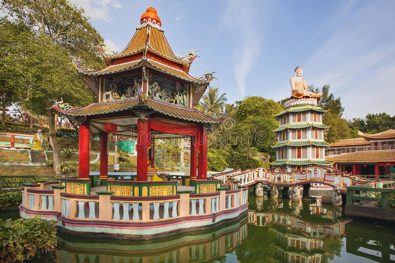 Chinese Pagoda and Pavilion by the Lake. SINGAPORE - FEBRUARY 1, 2014: Chinese Pagoda and Pavilion by the Lake at Haw Par Villa Theme Park. This theme park stock image