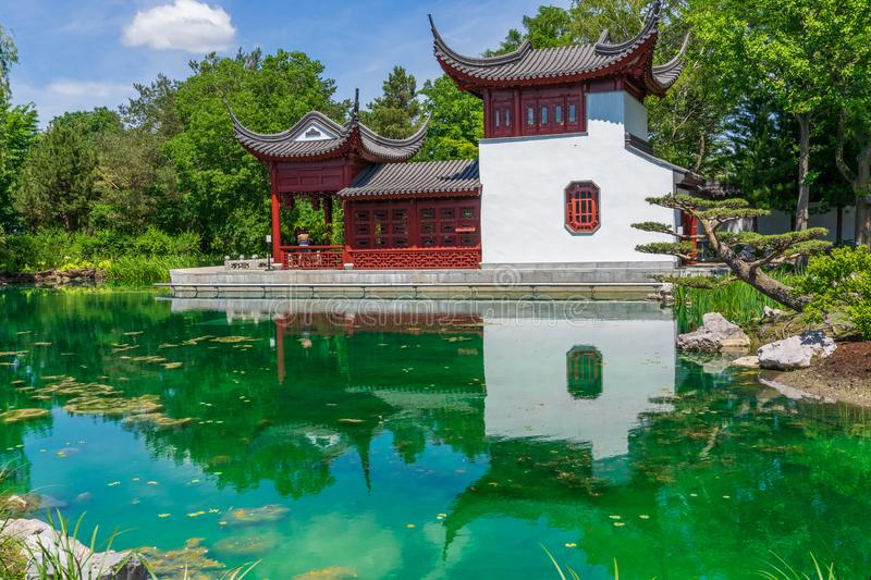 Chinese pagoda and pond at Montreal Botanical garden stock images