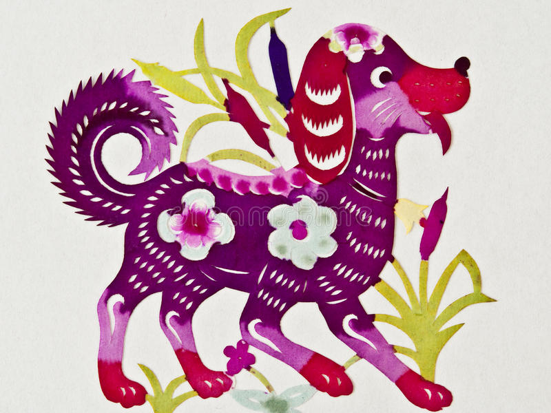 Chinese paper cutting dog. A color Chinese paper cutting dog with some flowers stock images