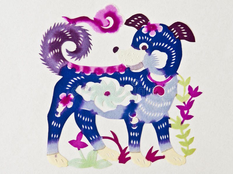 Chinese paper cutting dog. A color Chinese paper cutting dog with some flowers royalty free stock photo