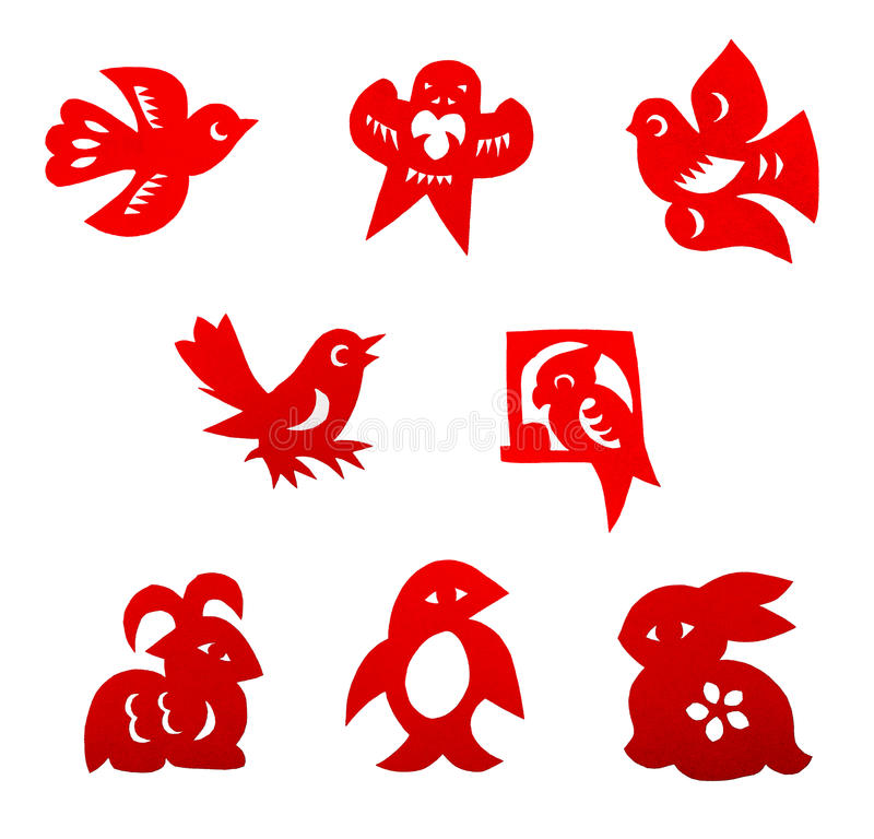 Chinese paper cutting set. A set of traditional china paper cuts in bright red color, with designs in cute animals for children, such as birds, parrot, rabbit stock image