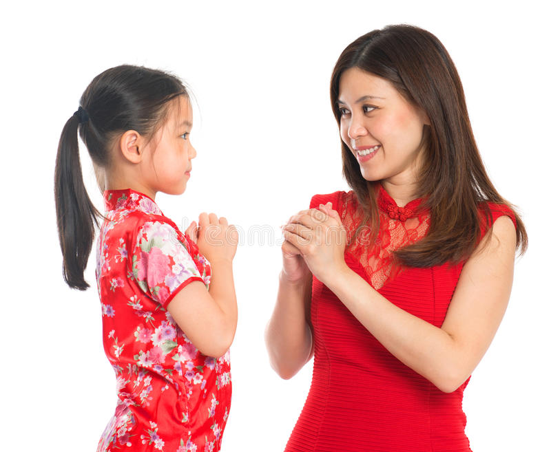 Chinese parent and child greeting to each other royalty free stock photography