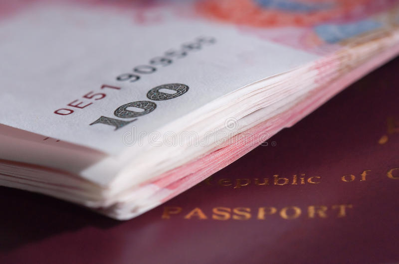 Chinese passport and currency stock photo