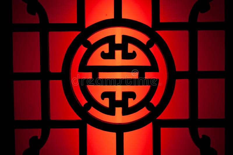 Chinese pattern. Wooden Chinese pattern with red background stock photography