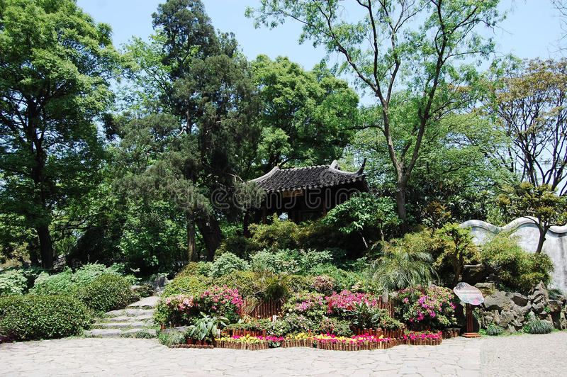Chinese pavilion. Is beset with trees and flowers royalty free stock photos