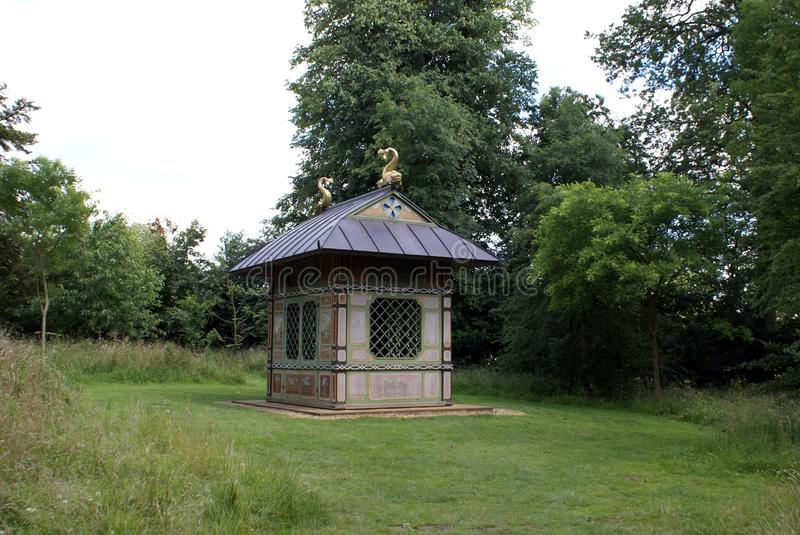 Chinese Pavilion, England. Decorative wooden Chinese pavilion with a painted canvas facade and sculptured roof stock photos