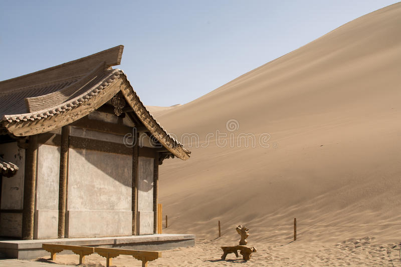 Chinese pavilion near the sand dunes in the desert. Dunhuang, China royalty free stock photo