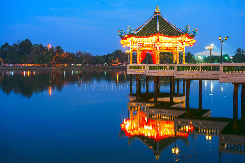 Chinese Pavilion at night. Architectue with reflection on lake royalty free stock photos