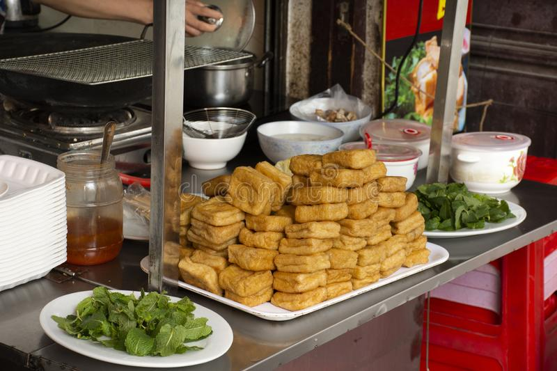Chinese people cooking Fried Tofu with vegetables and sweet sauce for severe to customer thai people at restaurant in Chaozhou. Or Teochew on May 8, 2018 in stock photo
