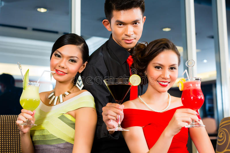 Chinese people drinking cocktails in luxury cocktail bar stock image