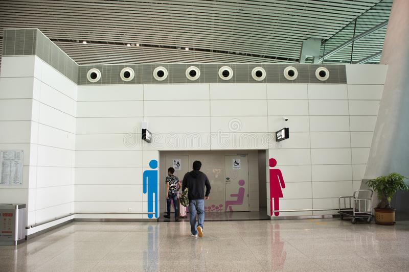 Chinese people and foreigner passengers go to toilet inside of Jieyang Chaoshan International Airport at Shantou, Guangdong, China royalty free stock photo