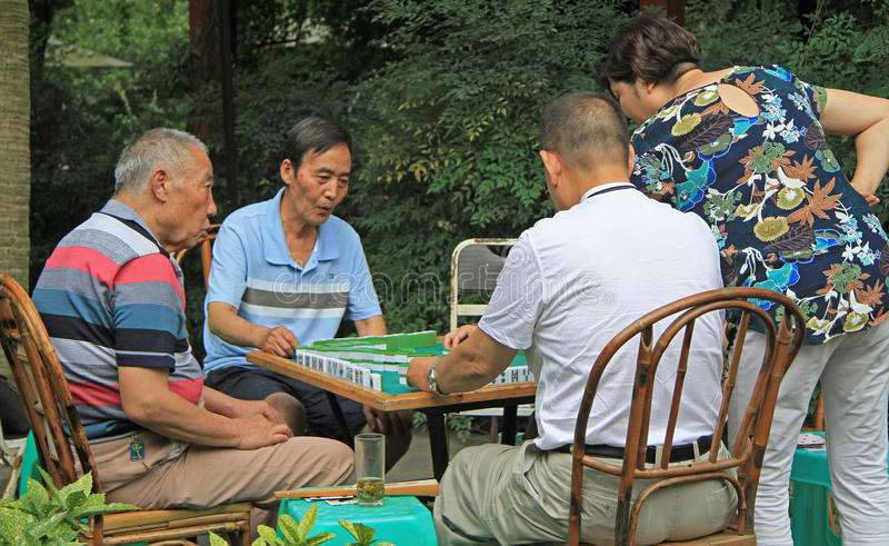 Chinese people are playing domino outdoor in park of Chengdu royalty free stock photos