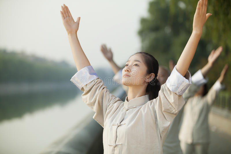 Download Chinese People Practicing Tai Ji, Arms Raised, Outdoors Stock Photo - Image of exercise, color: 31129170
