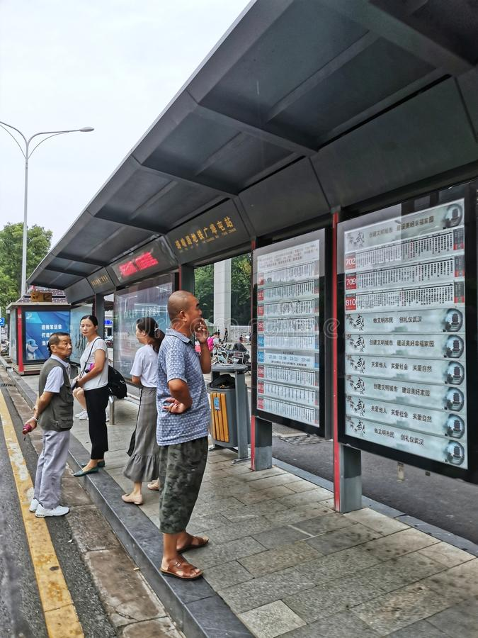Chinese people waiting for bus at bus station in Wuhan city. Chinese people waiting for bus at bus stop in Wuhan city hubei province china royalty free stock photo