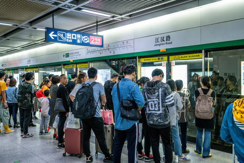 Chinese people waiting for the subway in an underground station on line 6 of Wuhan Metro in China stock photography
