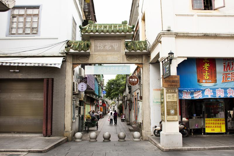 Chinese people walking in small alley at Paifang Street go to house in old town and ancient city center of Chaozhou town royalty free stock photo