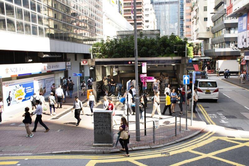 Chinese people walking up and down subway Wan Chai station in Hong Kong, China stock image