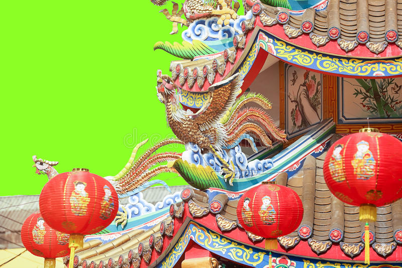Chinese phoenix on temple roof. Green screen background stock photo