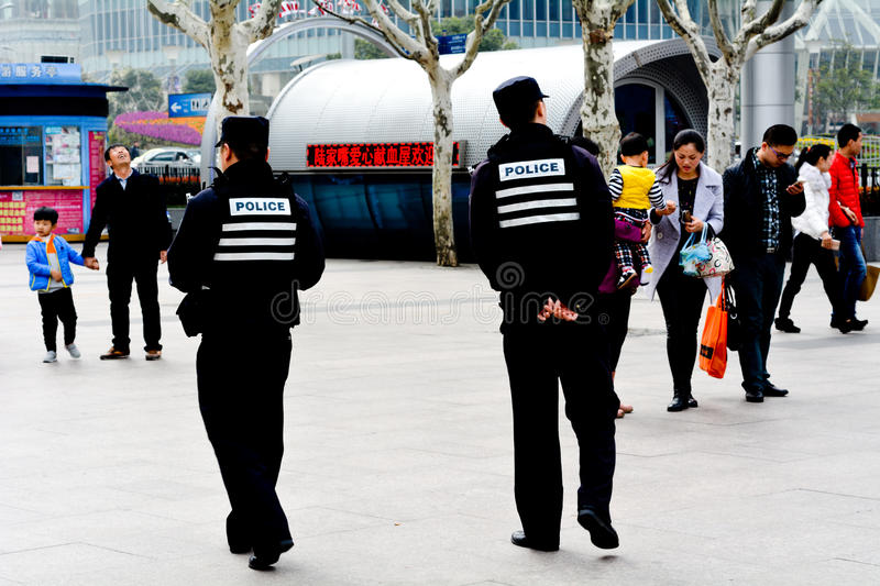 Chinese police officers guarding Nanjing Road in Shanghai, China stock photography