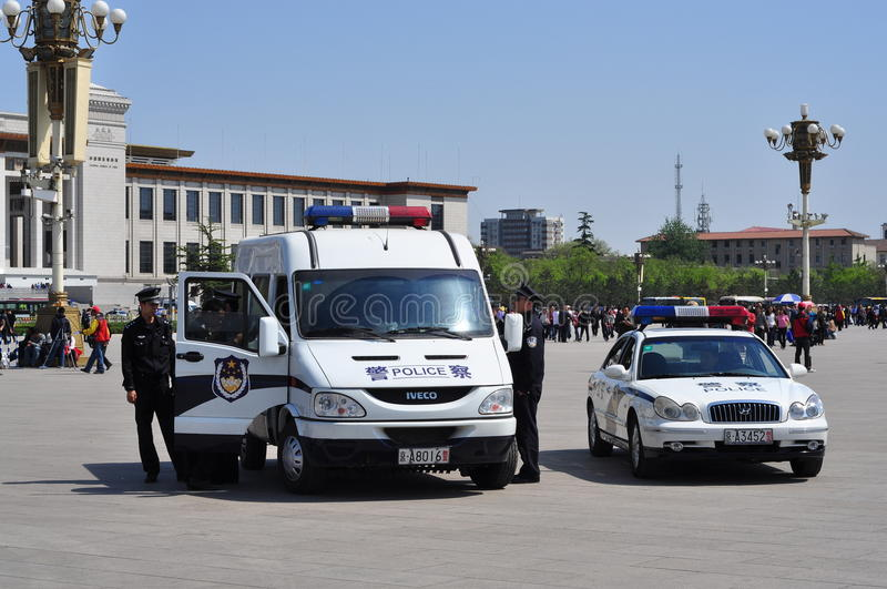 Chinese Police on patrolling Tiananmen Square 2 stock images