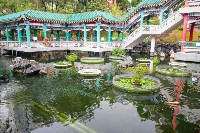 A Chinese pond and garden in Wong Tai Sin Temple, Hong Kong. A Chinese traditional pond and green garden in Sik Sik Yuen Wong Tai Sin Temple, a very famous stock photography