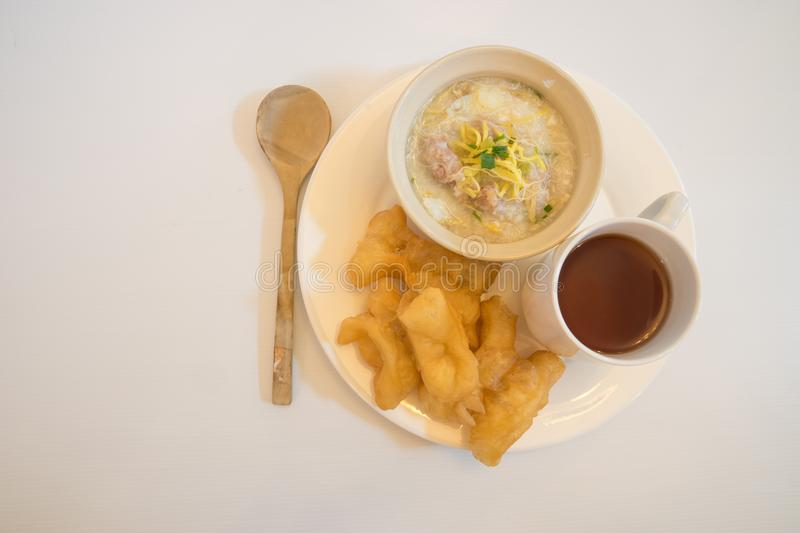 Chinese porridge in a bowel with chinese breadstick as breakfast royalty free stock images