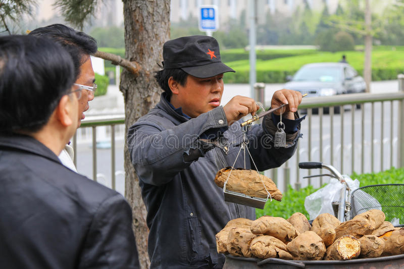 Chinese potato seller street food royalty free stock image