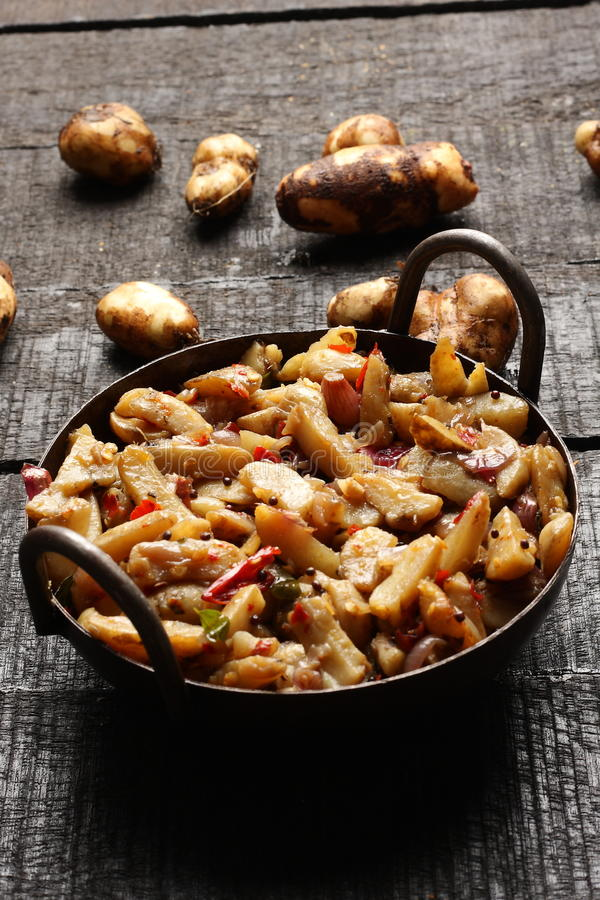 Chinese potato stir fry. Delicious Chinese potato stir fry in cast iron cookware royalty free stock images