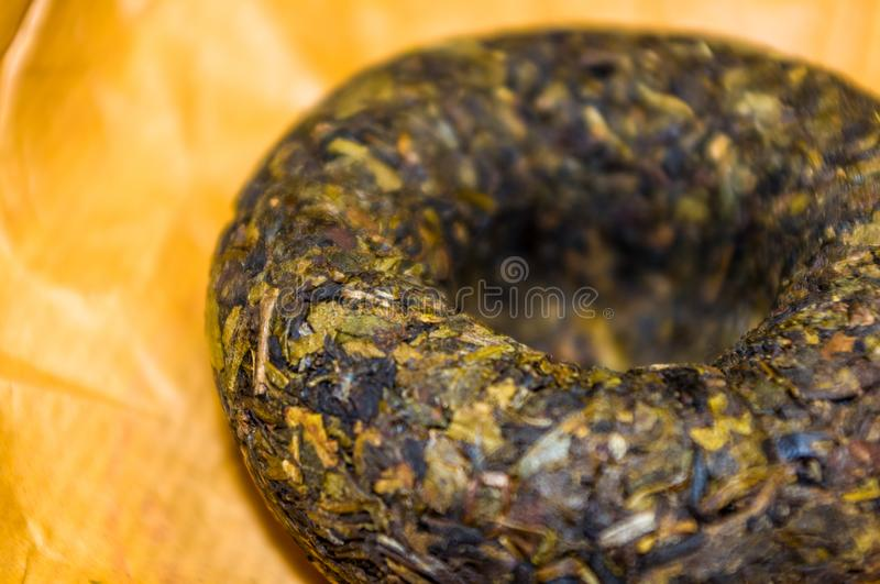 Chinese pressed puer tea on wrapping paper, close-up, macro royalty free stock image