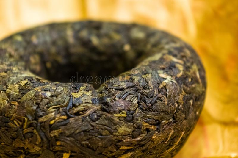 Chinese pressed puer tea on wrapping paper, close-up, macro. Chinese pressed puer tea on wrapping paper, close up, macro royalty free stock images
