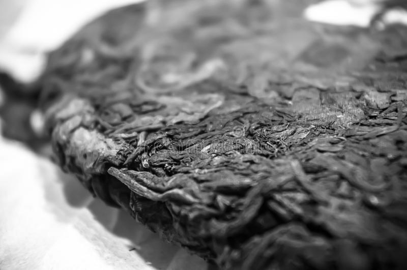 Chinese pressed puer tea on wrapping paper, close-up, macro. Chinese pressed puer tea on wrapping paper, close up, macro stock images