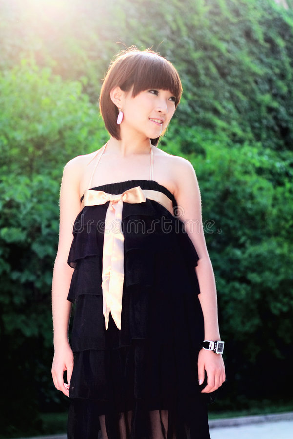Chinese pretty girl in a park stock photography