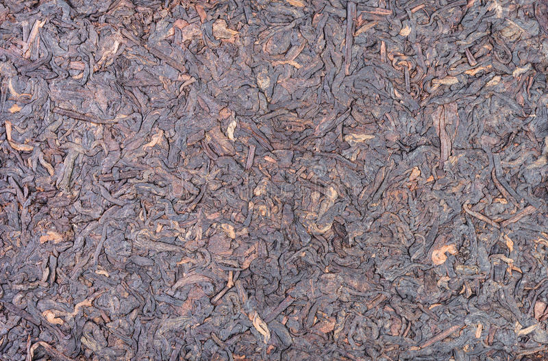 Chinese puer tea. Aged chinese puer tea brick as background royalty free stock image