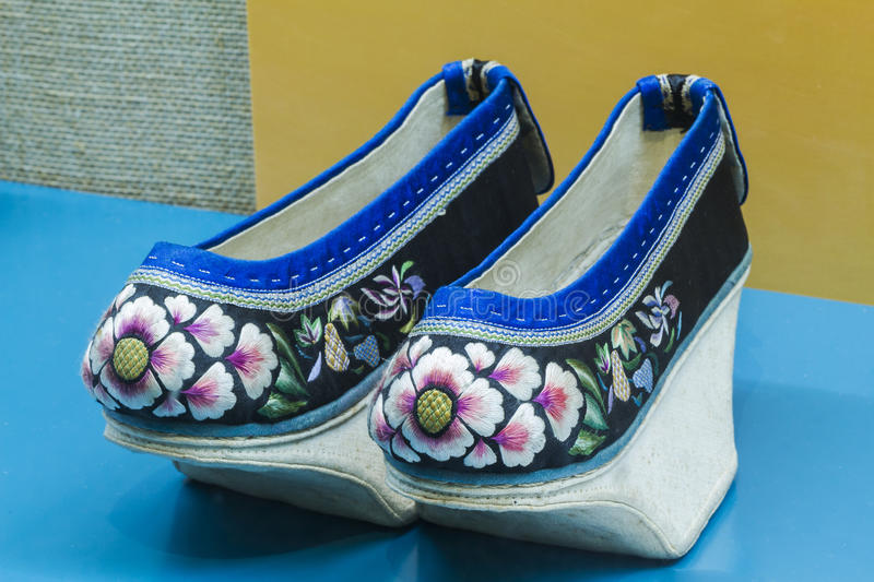 Chinese Qing high end embroidered shoes. Chinese qing dynasty aristocratic women wearing the high end of embroidered shoes, this kind of shoes is not only stock photos