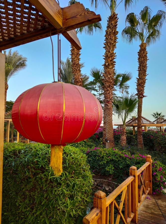 Chinese red lamp or lantern hanging on the wood terrace of the restaurant or café.Lantern festival backdrop stock photography